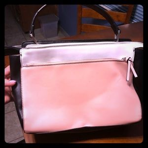 Pink, black and white purse
